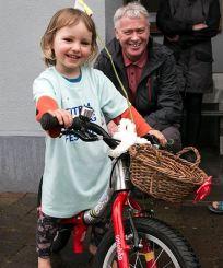 Georgie on her newly decorated balance bike.